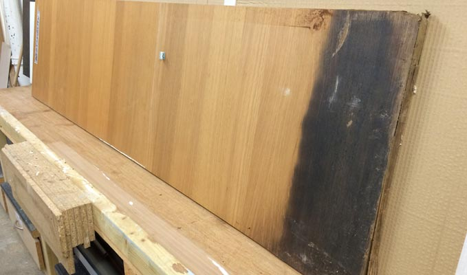 Flood damaged cupboard door which needs to have the wood grain matched